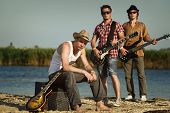 picture of hillbilly  - Three men with guitars on the river - JPG