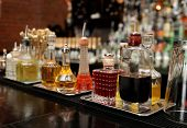 stock photo of bitters  - Bitters and infusions on bar counter - JPG