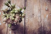 stock photo of pot  - Bouquet of roses in metal pot on the wooden background vintage style - JPG