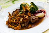 stock photo of deer meat  - Tenderloin of Roe Deer Back with Chanterelle - JPG