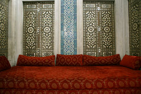 foto of eunuch  - Red chair and wall with tiles inside Topkapi palace - JPG