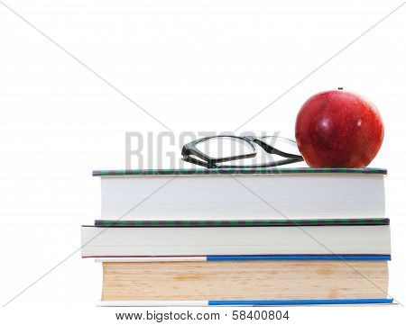 Red Apple And Glasses On Stacks Old And Newer Books