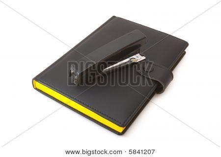 Black Diary (notebook) And Black Stapler