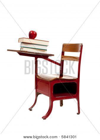Red School Desk With Books On White