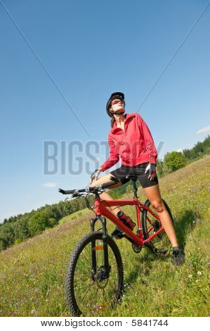 Young Sportive Woman On Mountain Bike