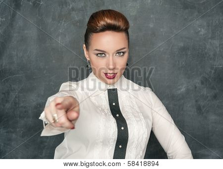 Beautiful Fashion Woman Pointing On Someone