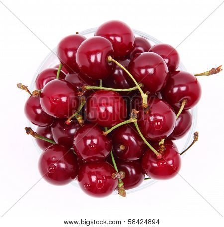 Ripe Fresh Cherry In The Glass Isolated On White Background