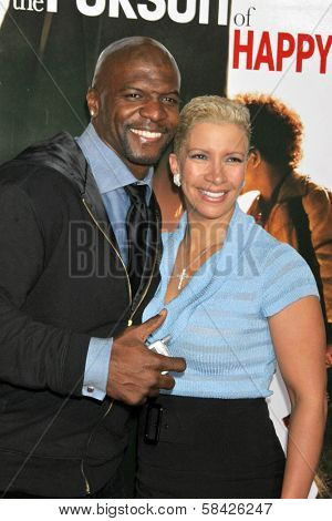 WESTWOOD, CA - DECEMBER 07: Terry Crews and wife Rebecca at the premiere of