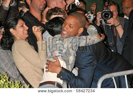 WESTWOOD, CA - DECEMBER 07: Will Smith and fans at the premiere of