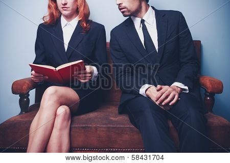 Businessman Looking At Businesswoman's Book