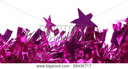 Closeup of christmas purple tinsel with stars.