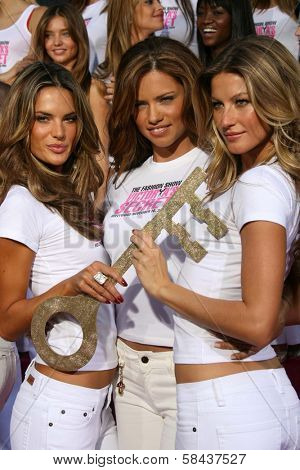 Alessandra Ambrosio with Adriana Lima and Gisele Bundchen receiving the Key to the City of Hollywood. Grauman's Chinese Theatre, Hollywood, California. November 15, 2006.