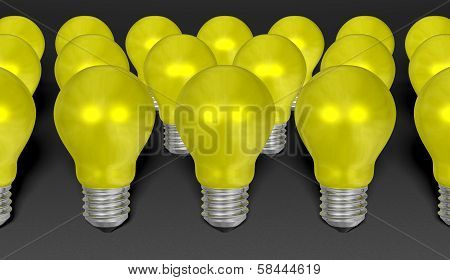 Group Of Yellow Reflective Light Bulbs On Grey Textured Background