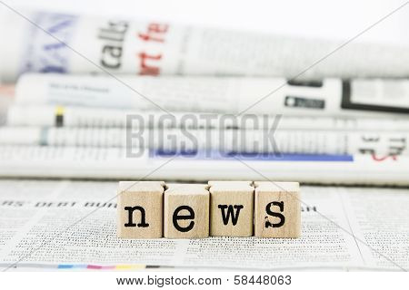 News Wording On Newspaper Background