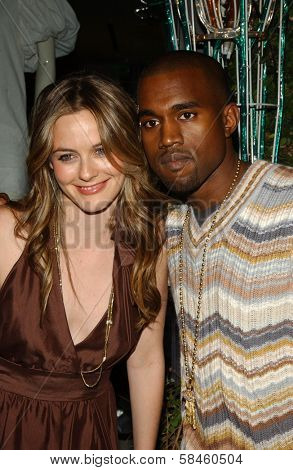 Alicia Silverstone and Kanye West Holiday Window Lighting to benefit the Kanye West Foundation Loop Dreams Program, Stella McCartney Boutique, Los Angeles, CA, December 5, 2006.