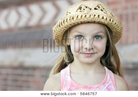 Portrait Of A Beautiful Little Girl In Hat