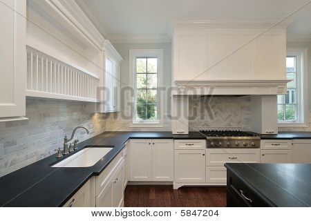 Kitchen With Black Countertops