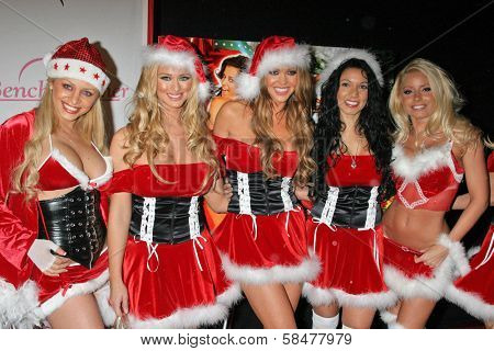 Mary Riley and Bench Warmer models at the Bench Warmer Trading Card's Holiday Party and Toy Drive. Area, Los Angeles, California. December 20, 2006.