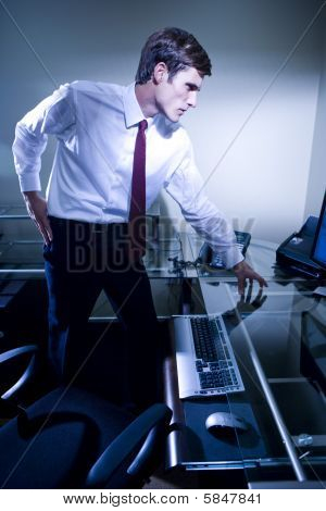 Young office worker at his desk