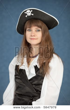 Beautiful Young Girl In A Pirate Hat On Blue Background