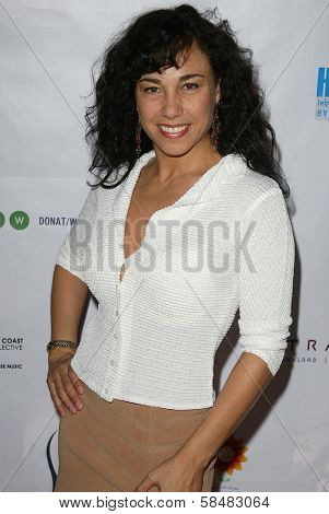 SANTA MONICA - JULY 23: Jackeline Olivier at the Sexy Summer Soire Party hosted by H.U.G.E benefiting Heal The Bay at AKWA Restaurant and Club on July 23, 2006 in Santa Monica, CA.