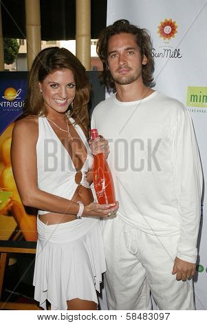 SANTA MONICA - JULY 23: Bridgetta Tomarchio and Will Kemp at the Sexy Summer Soire Party hosted by H.U.G.E benefiting Heal The Bay at AKWA Restaurant and Club on July 23, 2006 in Santa Monica, CA.