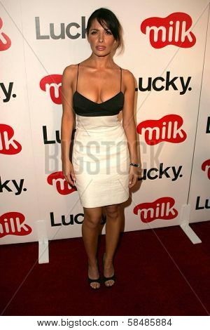 WEST HOLLYWOOD - AUGUST 10: Sarah Shahi at the Lucky Magazine LA Shopping Guide Party August 10, 2006 in Milk, West Hollywood, CA.