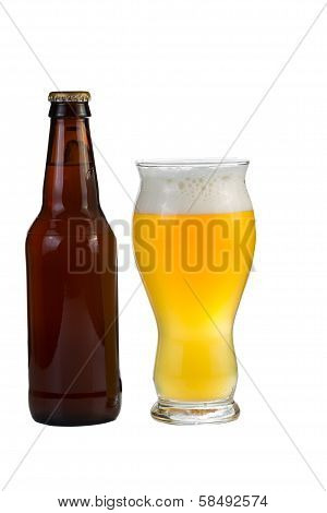 Unopened Bottle Of Beer Along With A Full Glass Of Beer