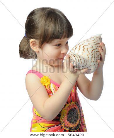 Little Girl With Seashell