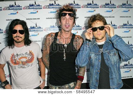 WEST HOLLYWOOD - JULY 13: Gilby Clarke with Tommy Lee and Jason Newsted at the party for the new season of