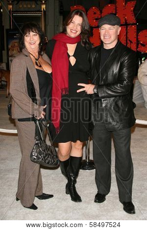 HOLLYWOOD - NOVEMBER 12: Neal McDonough with wife Ruve and guest at the world premiere of