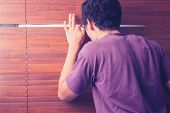 picture of pervert  - Young Man Peeping Out Through Venetian Blinds - JPG