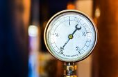 stock photo of manometer  - Detail of old pressure manometer on nice bokeh background - JPG