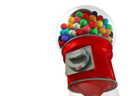 picture of gumball machine  - A regular red vintage gumball dispenser machine made of glass and reflective plastic with chrome trim filled with multicolored gumballs on an isolated white background - JPG