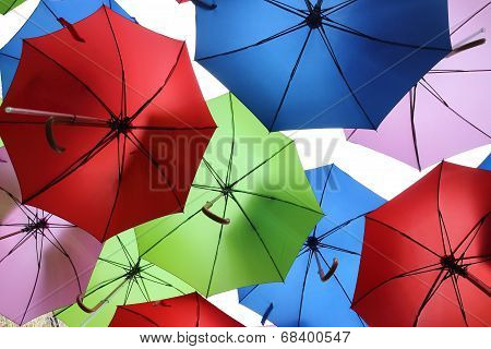 Colourful umbrellas hanging in the air