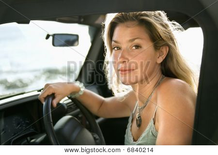 Blonde Woman Sitting In Car
