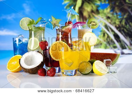 Tropical drink on beach and sun