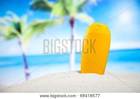 Suntan oil on beach
