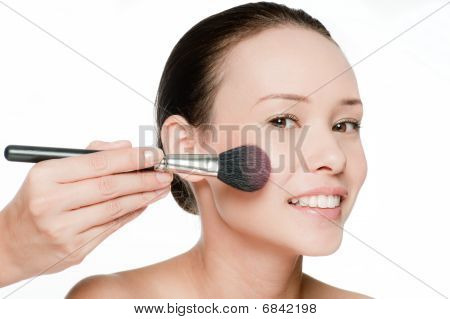 Young And Attractive Woman Applying Blusher