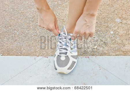 The Girl Tying Running Shoes.