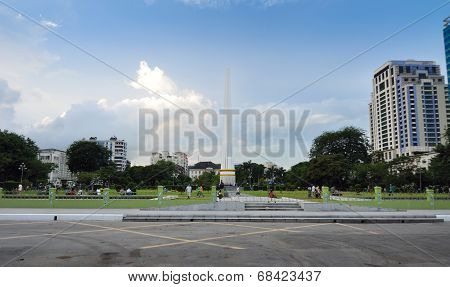 Yangon, Myanmar - October 12, 2013: Peopla Visit Independence Monument In Mahabandoola Park