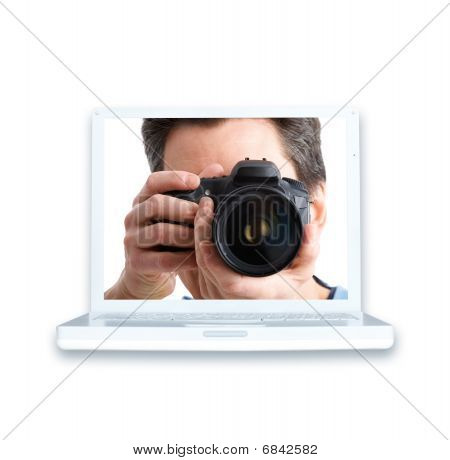 Man With Photo Camera And Laptop