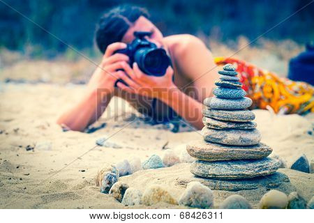Stock photographer take pictures of stone pyramid