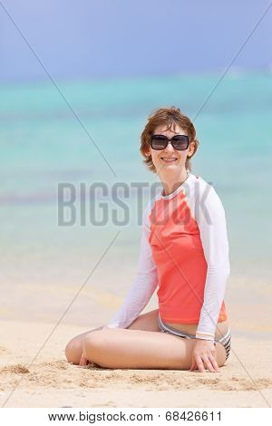 Woman In Rashguard At The Beach