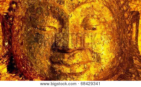 Face Of Buddha Image With Gold Foil