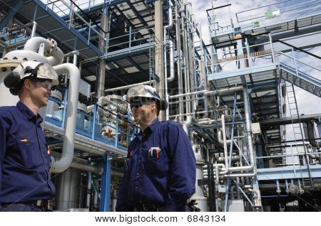 oil workers inside fuel refinery