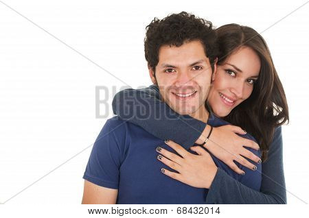 hispanic young couple hugging