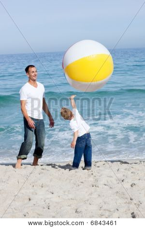 Happy Father And His Son Playing With A Ball
