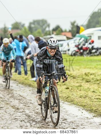The Cyclist Mark Renshaw On A Cobbled Road - Tour De France 2014