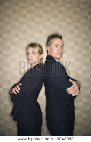 Business Man And Woman Back To Back
